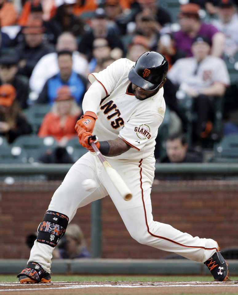 Photo - San Francisco Giants' Pablo Sandoval singles during the first inning of a baseball game against the Miami Marlins on Saturday, May 17, 2014, in San Francisco. (AP Photo/Marcio Jose Sanchez)