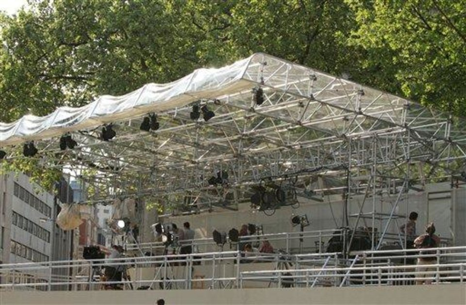 Photo - Lighting and camera mounts are placed into position on the media stand outside The Queen Elizabeth II Centre opposite Westminster Abbey, in central London Monday April 25, 2011 ahead of the royal wedding between Britain's Prince William, grandson of Queen Elizabeth II, and Kate Middleton on Friday.