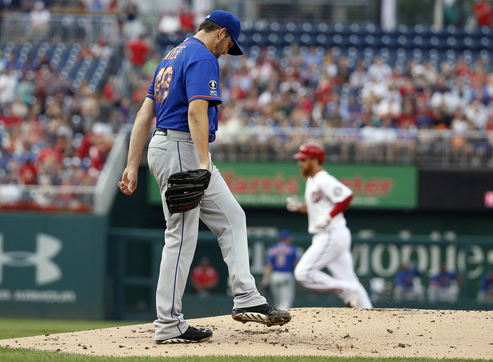 Photo - New York Mets starting pitcher Jonathon Niese walks back to the mound as Washington Nationals' Adam LaRoche rounds the bases for his two-run homer during the first inning of a baseball game at Nationals Park Wednesday, Aug. 6, 2014, in Washington. (AP Photo/Alex Brandon)