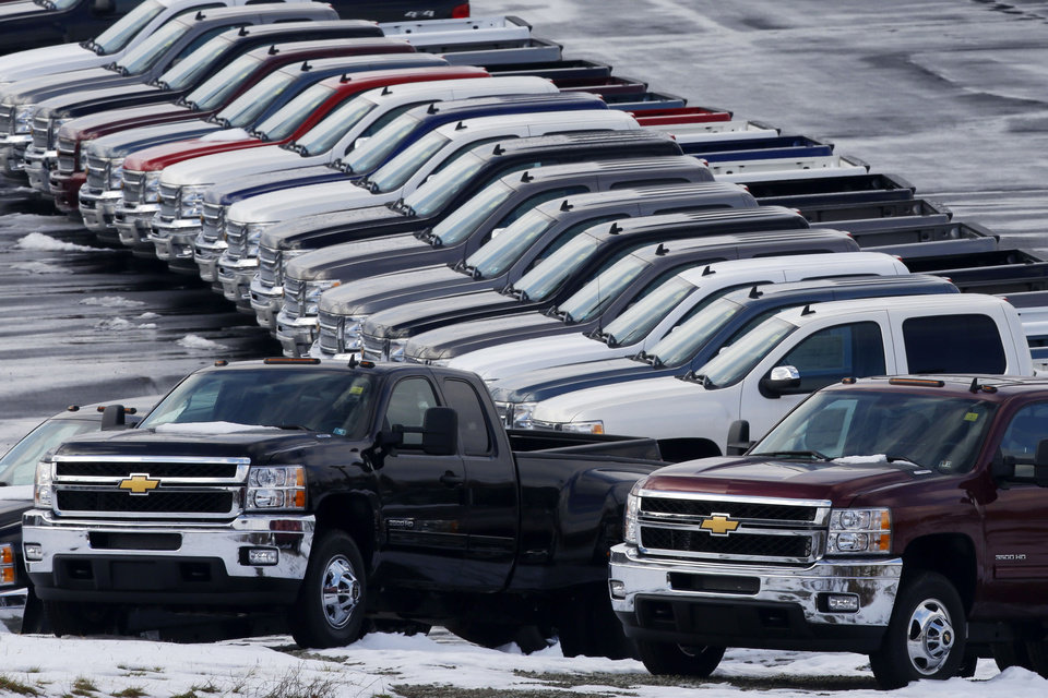 Photo - In this Wednesday, Jan. 9, 2013 photo, Chevy trucks line the lot of a dealer in Murrysville, Pa. Ford, Chrysler and General Motors all reported double-digit gains for January as last year's momentum in U.S. auto sales continued into 2013, according to reports Friday, Feb. 1, 2013. (AP Photo/Gene J. Puskar)