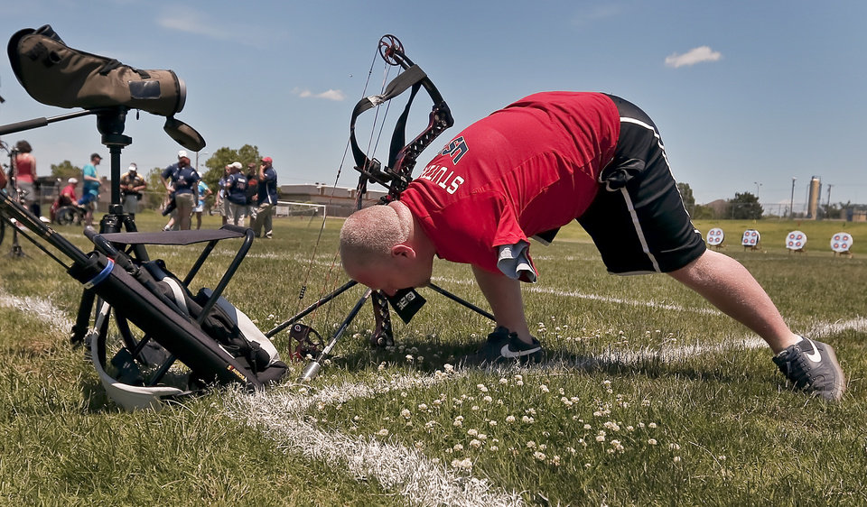 Matt Stutzman, known as the Armless Archer uses his mouth to set up his gear while taking part in the archery event during the Endeavor Games at the University of Central Oklahoma on Friday, June 7, 2013 in Edmond, Okla.  Photo by Chris Landsberger, The Oklahoman