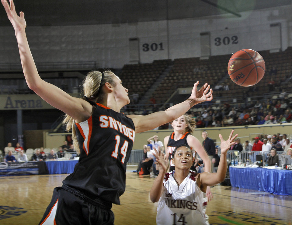 Photo - Snyder's Allie Ayers (14) goes for a loose ball against Northeast Maximina Gonzalez (14) during the semi final 2A girls State Basketball Championship game between Snyder High School and Northeast High School at the State Fair Arena on Friday, March 9, 2012 in Oklahoma City, Okla.  Photo by Chris Landsberger, The Oklahoman