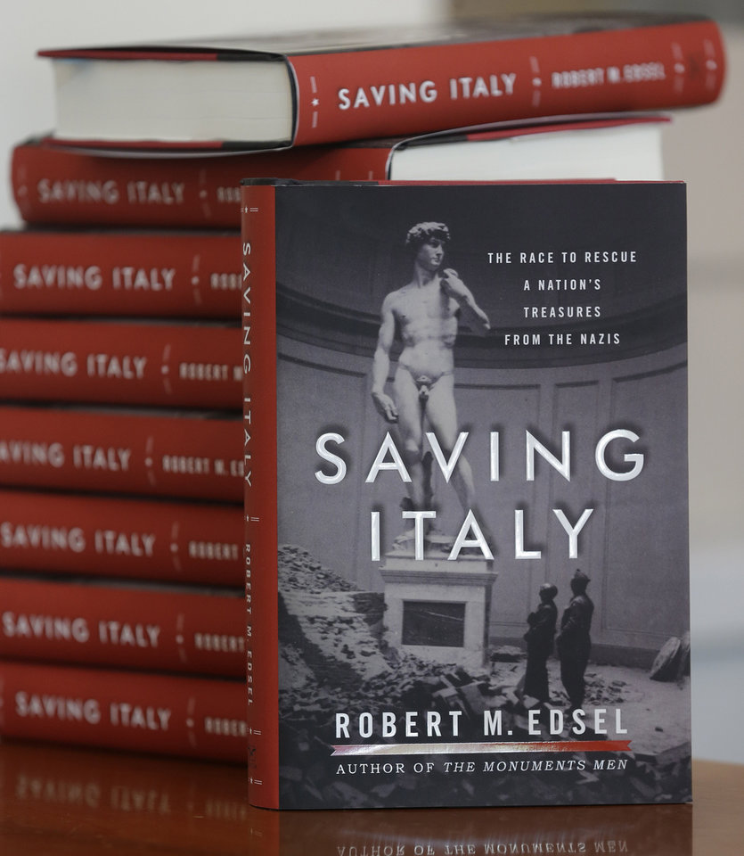 Photo - This photo taken April 29, 2013 shows copies of the book titled Saving Italy by Robert Edsel, founder of the Monuments Men Foundation for the Preservation of Art, in Dallas. Edsel started his foundation in 2007 to honor and continue the work of the Monuments Men, the roughly 345 men and women from 13 nations who helped protect cultural treasures during World War II. (AP Photo/LM Otero)