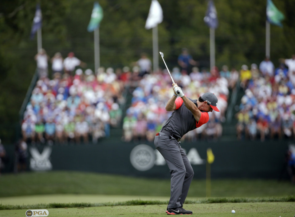 Photo - Rory McIlroy, of Northern Ireland, hits his tee shot on the eighth hole during the first round of the PGA Championship golf tournament at Valhalla Golf Club on Thursday, Aug. 7, 2014, in Louisville, Ky. (AP Photo/David J. Phillip)