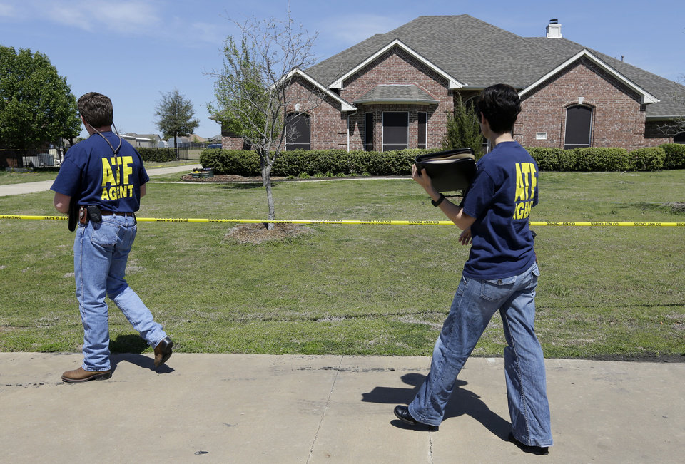 Photo - ATF agents walk into the home of Kaufman District Attorney Mike McLelland Monday, April 1, 2013, near Forney, Texas. McLelland and his wife were murdered on Saturday at their home. (AP Photo/Tony Gutierrez)