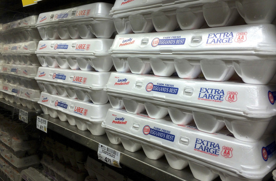 Photo - FILE - This July 6, 2016, file photo shows egg cartons displayed on a shelf at a market in San Francisco. More than a dozen states want the U.S. Supreme Court to block a California law requiring any eggs sold there to come from hens that have space to stretch out in their cages. A lawsuit filed Monday, Dec. 4, 2017 with the high court alleges California's law has cost consumers nationwide up to $350 million annually because of higher egg prices since 2015. (AP Photo/Jeff Chiu, File)