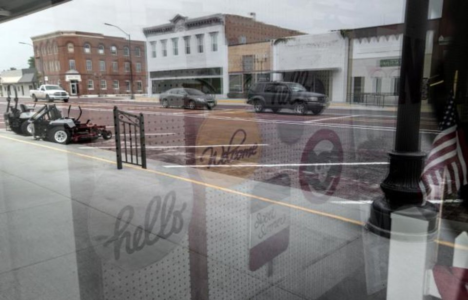 Photo -  Main Street is reflected in a display window of a store in Scribner, Neb. [AP PHOTO]
