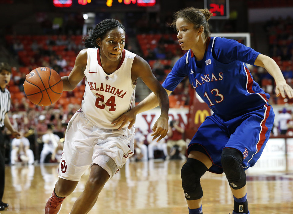 Oklahoma Sooner\'s Sharane Campbell (24) is guarded buy Kansas Jayhawks\' Monica Engelman (13) in the second half as the University of Oklahoma Sooners (OU) defeat the Kansas Jayhawks 85-77 in NCAA, women\'s college basketball at The Lloyd Noble Center on Saturday, March 2, 2013 in Norman, Okla. Photo by Steve Sisney, The Oklahoman