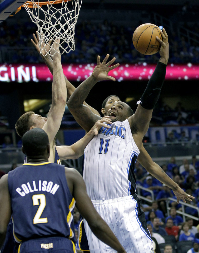 Photo -   Orlando Magic's Glen Davis (11) goes up for a shot past the Indiana Pacers defense including Darren Collison (2), and Tyler Hansbrough, back left, during the first half of Game 3 of an NBA first-round playoff basketball series, Wednesday, May 2, 2012, in Orlando, Fla. (AP Photo/John Raoux)