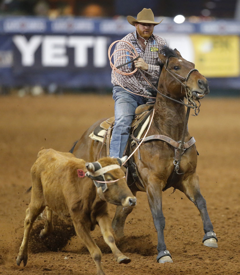 Photo - Coby Doescher of Webbers Falls, Okla., competes in the heading event during the Timed Event Championship inside the Lazy E Arena in Guthrie, Okla., Friday, March 13, 2020. [Bryan Terry/The Oklahoman]