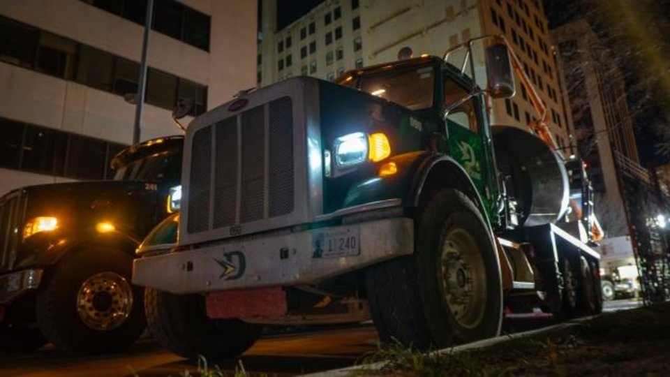 Photo -  150 cement trucks decended on downtown Oklahoma CIty overnight to pur the foundation for a ramp to a new parking garage for First National Center. [DAVE MORRIS/The Oklahoman]