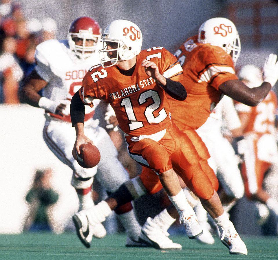 OSU quarterback Mike Gundy scrambles during Bedlam football game in Stillwater. PHOTO BY PAUL HELLSTERN, THE OKLAHOMAN ARCHIVES <strong>Paul Hellstern</strong>