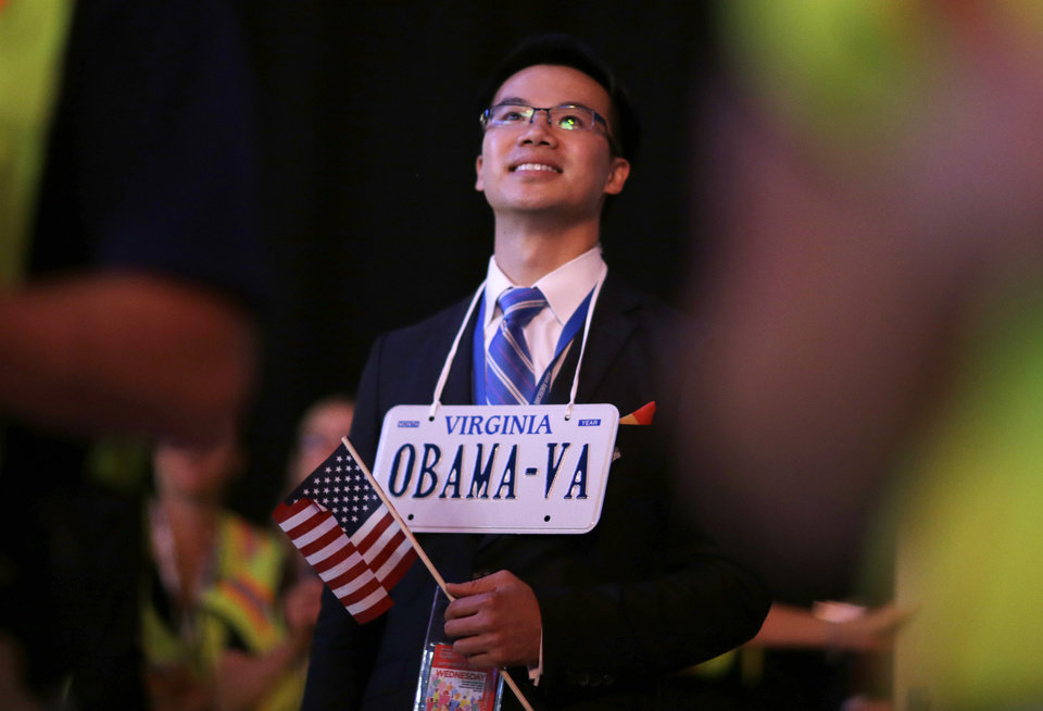 Photo - Virginia delegate Linh Hoang watches during the Democratic National Convention in Charlotte, N.C., on Wednesday, Sept. 5, 2012. (AP Photo/David Goldman)  ORG XMIT: DNC759