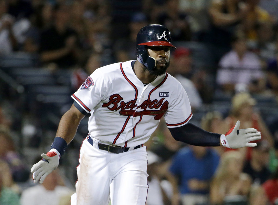 Photo - Atlanta Braves' Jason Heyward claps after hitting a single to score teammate Andrelton Simmons in the seventh inning of a baseball game against the Miami Marlins, Friday, Aug. 29, 2014, in Atlanta. (AP Photo/David Goldman)