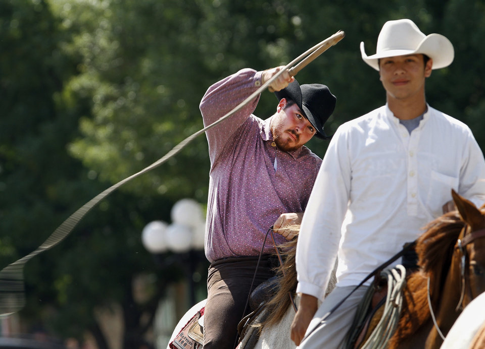 A rider cracks a whip while riding in the afternoon parade through downtown Pawnee  on Saturday,  June 23, 2012.  Photo by Jim Beckel, The Oklahoman
