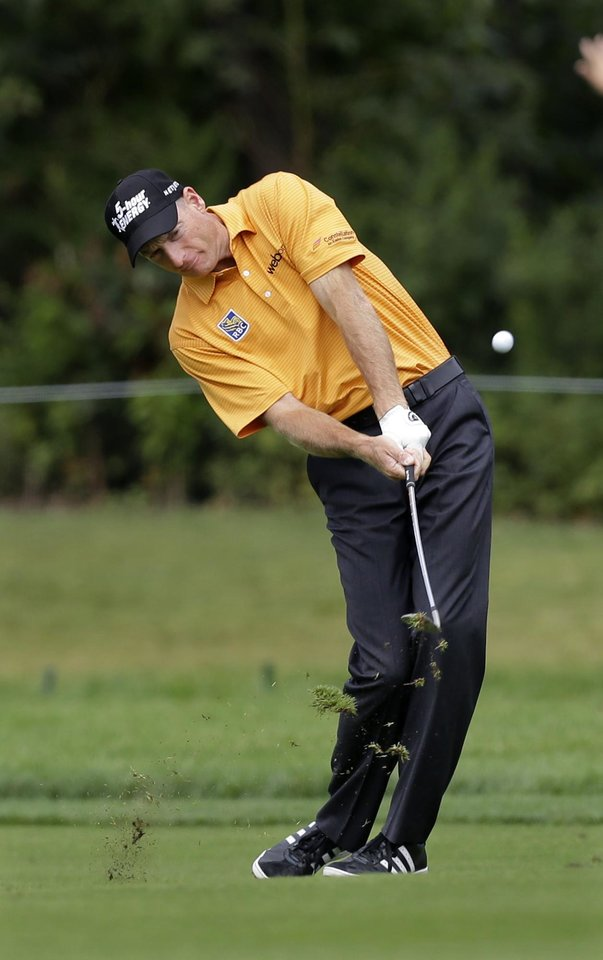 Photo - Jim Furyk hits a fairway shot on the first hole during the third round of play at The Barclays golf tournament Saturday, Aug. 23, 2014, in Paramus, N.J. (AP Photo/Mel Evans)