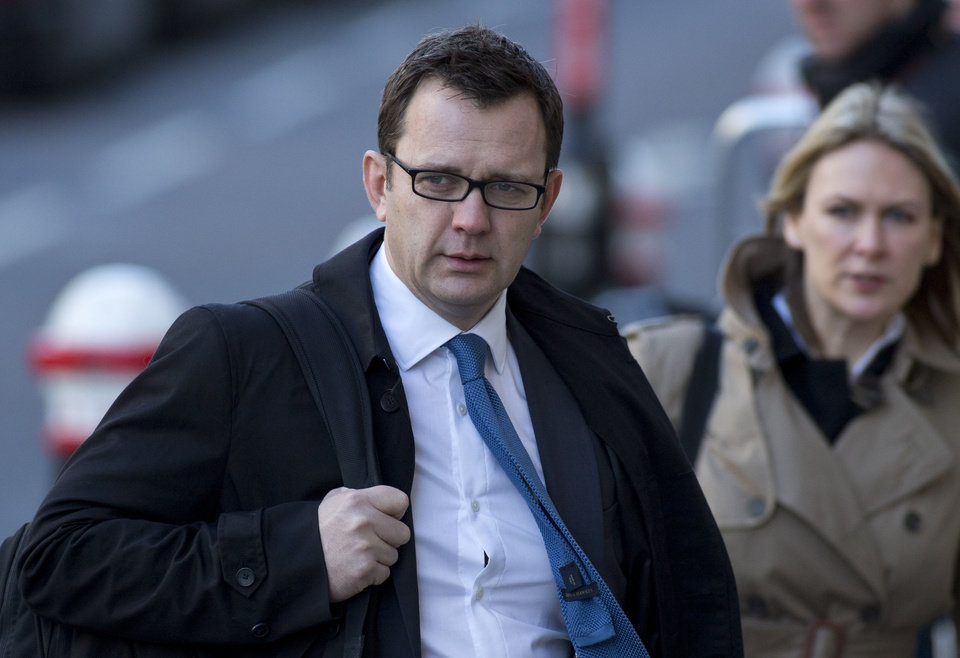 FILE - This is a  Friday, Feb.  21, 2014 file photo of Andy Coulson, former News of the World editor and former aide to British Prime Minister David Cameron arrives at the Central Criminal Court in London. Former News of the World editor Andy Coulson has been convicted of phone hacking, on Tuesday June 24, 2014   but fellow editor Rebekah Brooks was acquitted after a months long trial centring on illegal activity at the heart of Rupert Murdoch's newspaper empire. (AP Photo/Alastair Grant, File)