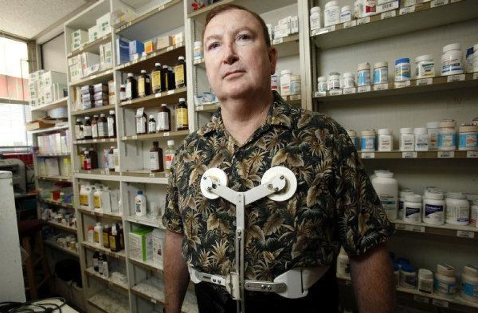 PHARMACIST / SHOOTING DEATH / ATTEMPTED ROBBERY / ATTEMPT: Dr. Jerome Ersland stands near medications at Reliable Discount Pharmacy, 5900 S Pennsylvania earlier this week in Oklahoma City, Thursday, May 21, 2009. Photo by Sarah Phipps, The Oklahoman  ORG XMIT: KOD