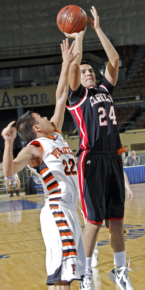 Carnegie's Jerry Collins (24) puts up a shot over Preston's Jesse Bear (22) during the first round 2A boy's State Basketball Championship game between Preston High School and Carnegie High School at the State Fair Arena on Thursday, March 8, 2012 in Oklahoma City, Okla.  Photo by Chris Landsberger, The Oklahoman