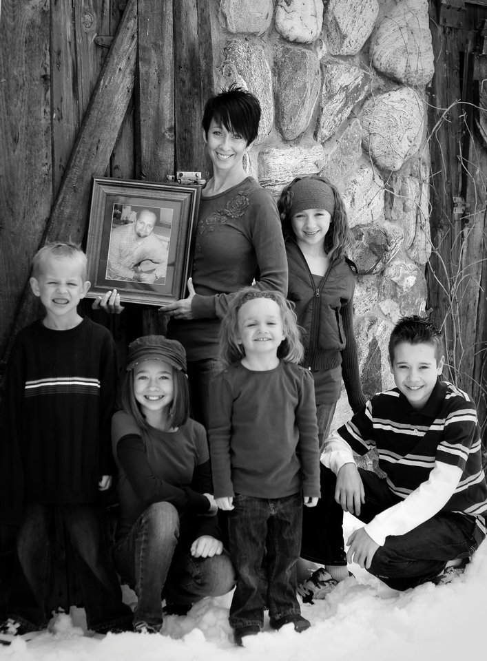 Photo -       Michelle Eborn and her children. Her husband died in 2006 when they were both 34.