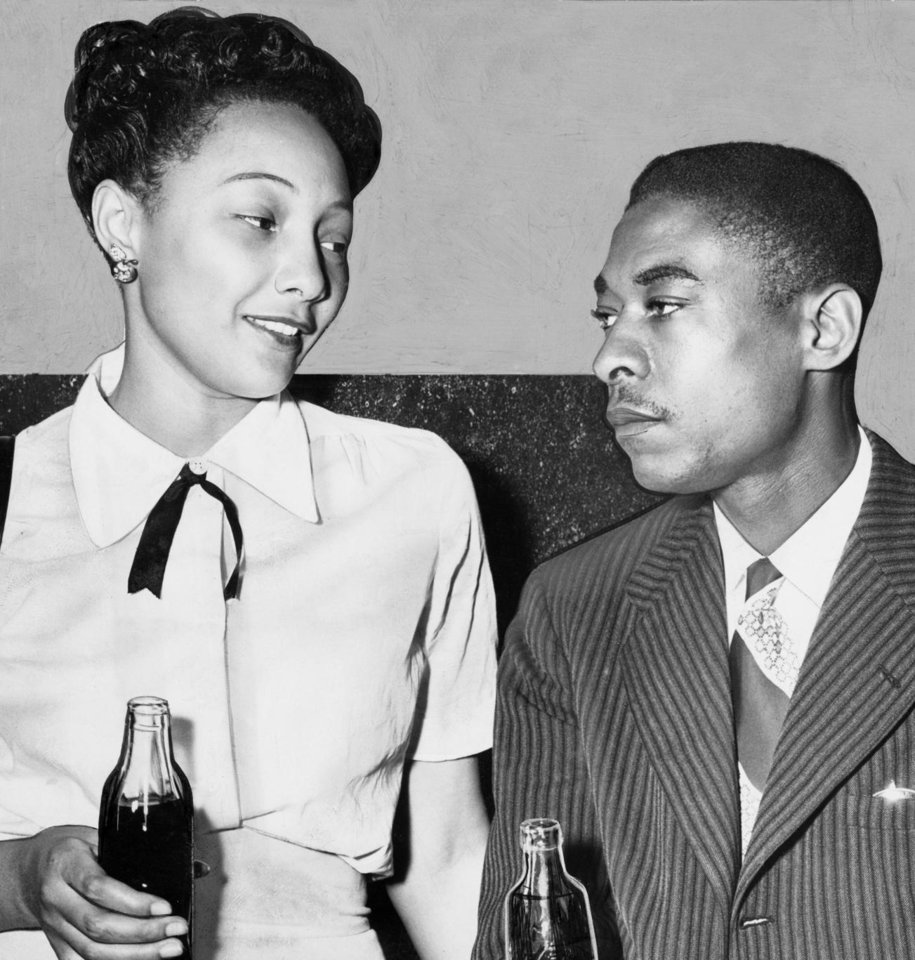 Photo - OU: Ada Lois Sipuel Fisher and her husband, Warren Fisher, a Tinker Field employee, relax with soft drinks during a court recess in Norman. Fisher was fighting to gain admission to the University of Oklahoma law school. (Photo was published May 26, 1948, in The Daily Oklahoman)