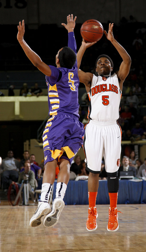 Photo - Stephen Clark of Douglass shoots the ball beside Anadarko's Kyle Bert during the Class 4A boys high school state basketball championship game at State Fair Arena in Oklahoma City, Saturday, March 10, 2012. Photo by Bryan Terry, The Oklahoman