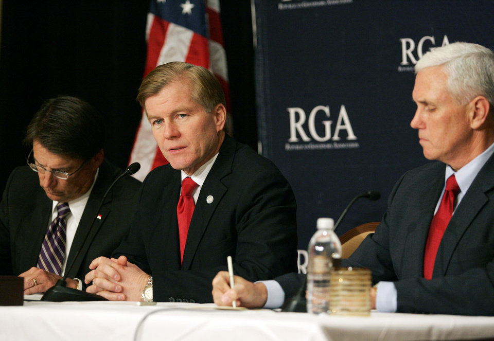 Photo -   Republican Governors Association Chairman and Virginia Gov. Bob McDonnell, center, leads a news conference at the 2012 RGA Annual Conference at Encore hotel-casino Thursday, Nov. 15, 2012, in Las Vegas. North Carolina Governor-Elect Pat McCrory, left, and Indiana Governor-Elect Mike Pence sit nearby. (AP Photo/Ronda Churchill)