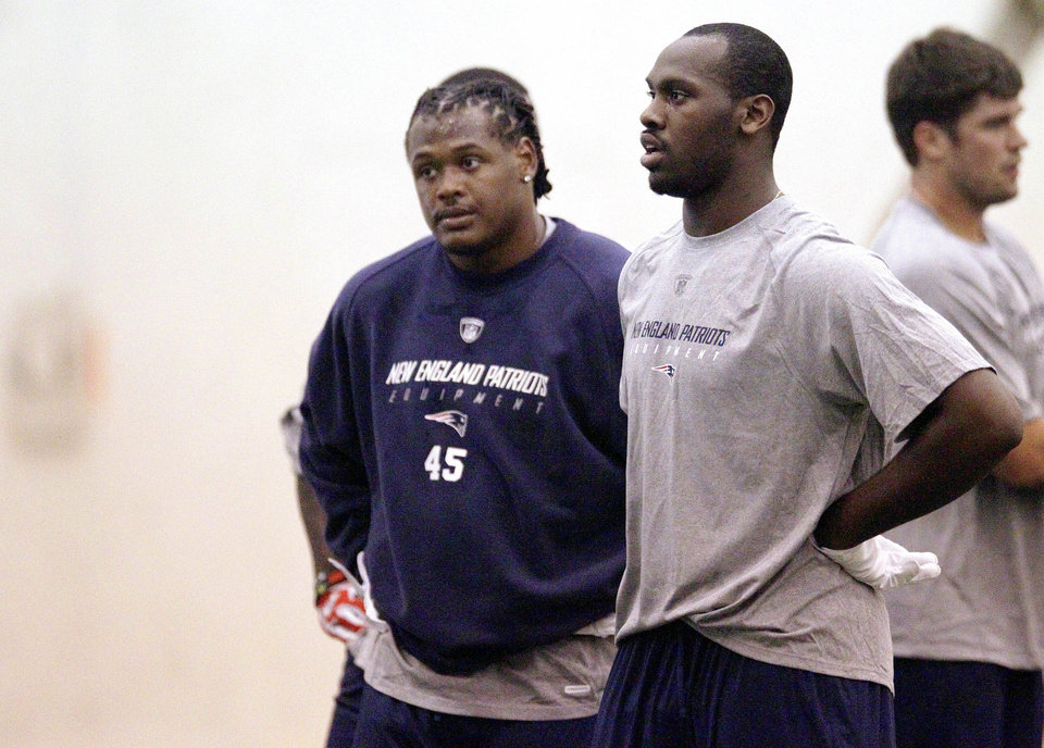 Photo -   New England Patriots defensive rookie players Dont'a Hightower (45) and Chandler Jones, both selected in the first round of the draft, catch their breath during NFL football rookie minicamp at the team's facility in Foxborough, Mass., Friday, May 11, 2012. (AP Photo/Stephan Savoia)