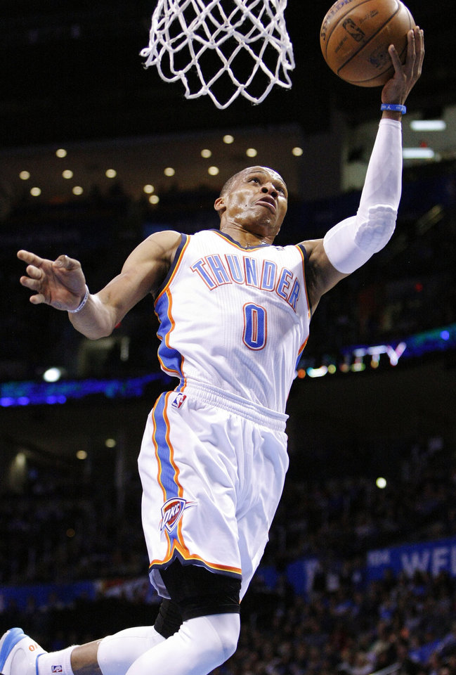 Oklahoma City Thunder guard Russell Westbrook (0) goes to the basket against the New Orleans Hornets during the second quarter of an NBA basketball game in Oklahoma City, Wednesday, Feb. 27, 2013. (AP Photo/Alonzo Adams)