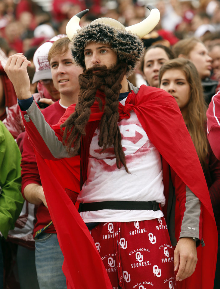 Phil Dumphey, Broken Arrow Sophomore, dresses in costume in the student section during a college football game between the University of Oklahoma Sooners (OU) and the Texas Tech Red Raiders at Gaylord Family-Oklahoma Memorial Stadium in Norman, Okla., on Saturday, Oct. 26, 2013. Photo by Steve Sisney, The Oklahoman
