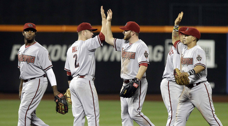 Arizona Diamondbacks' Aaron Hill (2) celebrates after a baseball game against the New York Mets, Friday, May 4, 2012, in New York. The Mets lost 5-4. (AP Photo/Frank Franklin II)