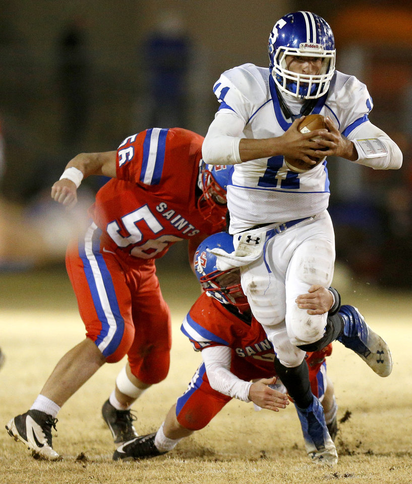 Photo - Stroud's Alex Hinds is brought down by  Oklahoma Christian School's Braden Werner, left, and Palmer Rice during a high school football playoff game in Edmond, Friday, Nov. 23, 2012. Photo by Bryan Terry, The Oklahoman