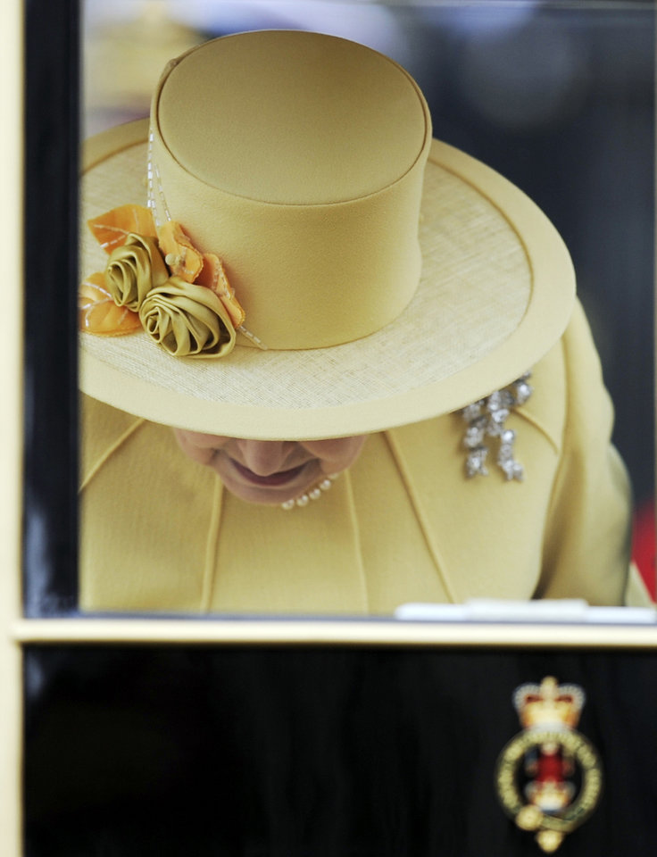Photo - Britain's Queen Elizabeth II gets inside a carriage outside Westminster Abbey after the Royal Wedding for Britain's Prince William and his wife Kate, Duchess of Cambridge in London Friday, April, 29, 2011. (AP Photo/Martin Meissner)  (AP Photo/Martin Meissner) ORG XMIT: RWMG166