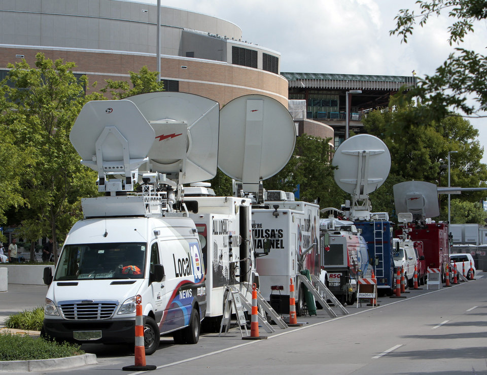 OKLAHOMA CITY THUNDER / MIAMI HEAT / NBA FINALS / NBA BASKETBALL / CHESAPEAKE ENERGY ARENA: Satellite trucks are parked along Robinson Avenue west of the Cox Convention Center for the NBA basketball finals at the Chesapeake Arena on Wednesday, June 13, 2012 in Oklahoma City, Okla.  Photo by Steve Sisney, The Oklahoman