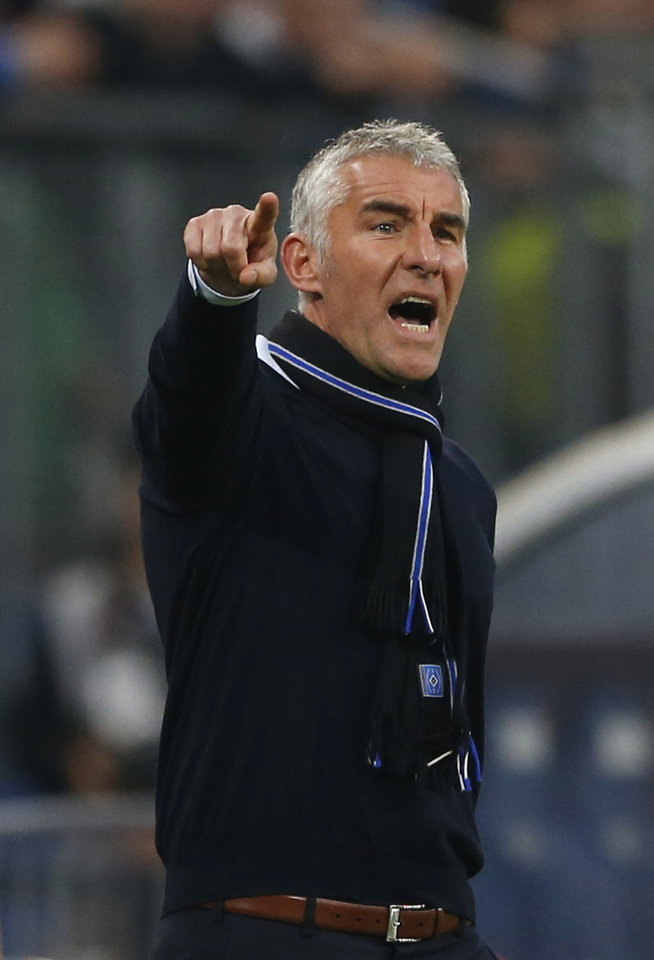 Photo - Hamburg head coach Mirko Slomka gestures during the 1st leg relegation soccer match between Hamburger SV and Greuther Fuerth in Hamburg, Germany, Thursday, May 15, 2014.  (AP Photo/Matthias Schrader)