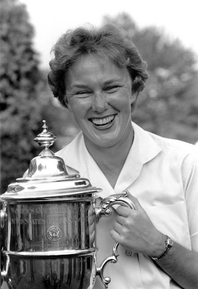 Photo -  Mickey Wright poses after winning her third Women's National Open golf championship in 1961. (AP Photo/File)