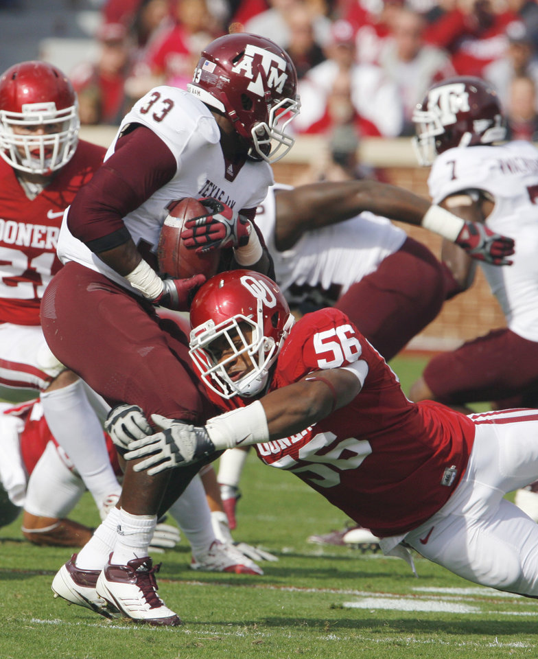 Ronnell Lewis (56) tackles Christine Michael (33) during the first half of the college football game between the Texas A&M Aggies and the University of Oklahoma Sooners (OU) at Gaylord Family-Oklahoma Memorial Stadium on Saturday, Nov. 5, 2011, in Norman, Okla. Photo by Steve Sisney, The Oklahoman