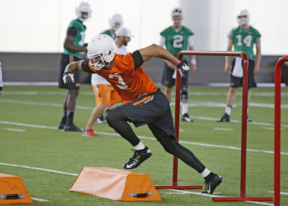 Photo -  Oklahoma State receiver Marcell Ateman participates in spring drills inside the Sherman E. Smith Center. Ateman received a medical hardship waiver last season after a cracked bone in his foot kept him off the field all year. [PHOTO BY STEVE GOOCH, THE OKLAHOMAN]