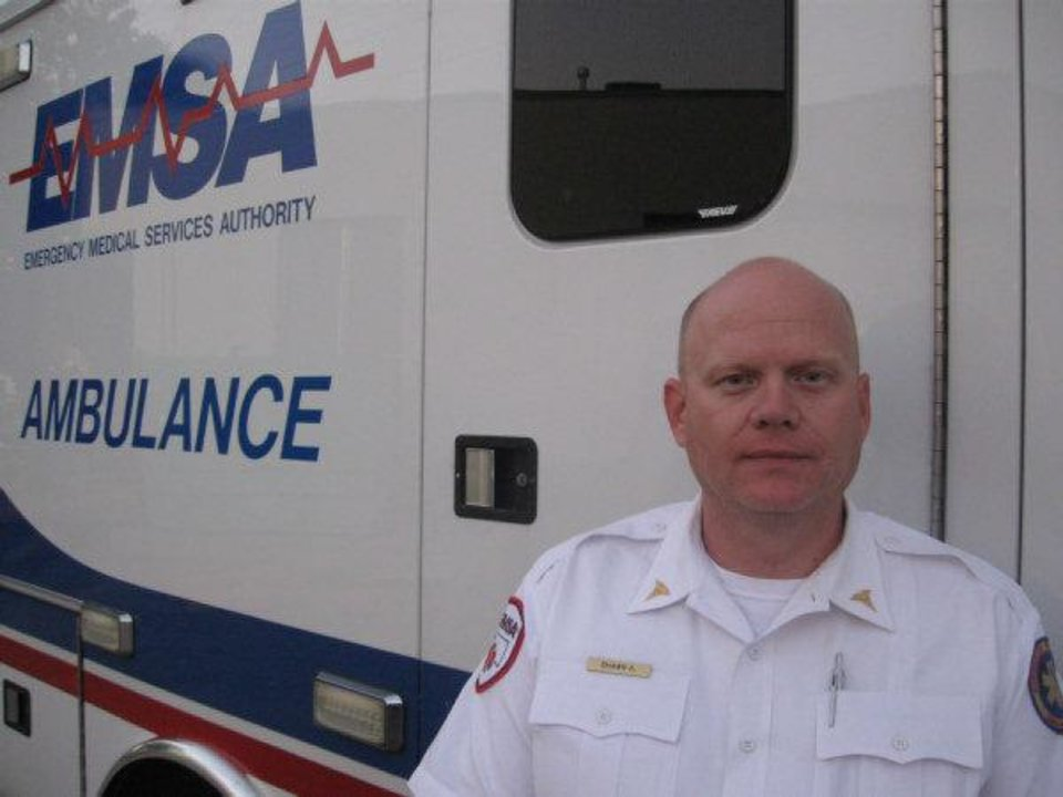 Photo - Shawn Altebaumer, an EMSA paramedic who came upon a group of motorists grabbing money from a bank bag dropped on Interstate 40 near Meridian Avenue Monday afternoon.