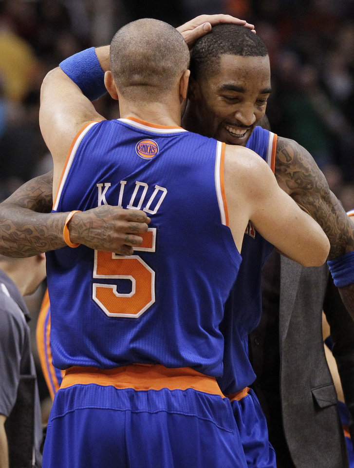 Photo - New York Knicks' Jason Kidd (5) celebrates with teammate J.R. Smith after Smith hit a game-winning basket against the Phoenix Suns during the second half of an NBA basketball game on Wednesday, Dec. 26, 2012, in Phoenix. The Knicks won 99-97. (AP Photo/Matt York)