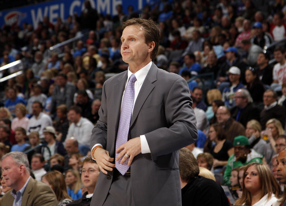 Photo - Oklahoma City head coach Scott Brooks watches game action during the NBA basketball game between the Oklahoma City Thunder and the Miami Heat Sunday Jan. 18, 2009, at the Ford Center in Oklahoma City. PHOTO BY SARAH PHIPPS, THE OKLAHOMAN ORG XMIT: KOD