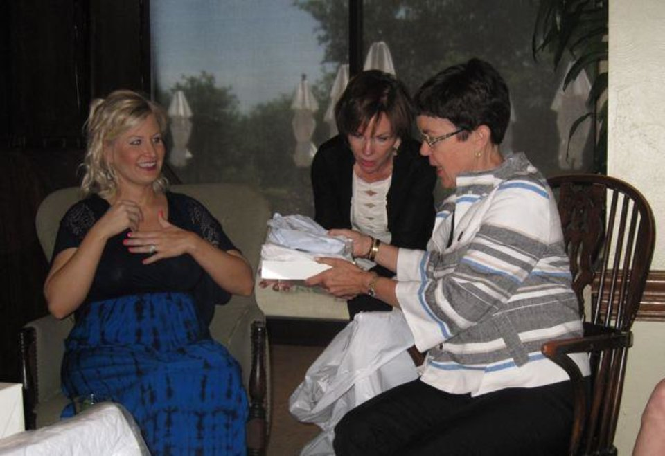 Reistle Cohenour, Susan Sigmon and Patty Cohneour check out the shower gifts. (Photo by Helen Ford Wallace).