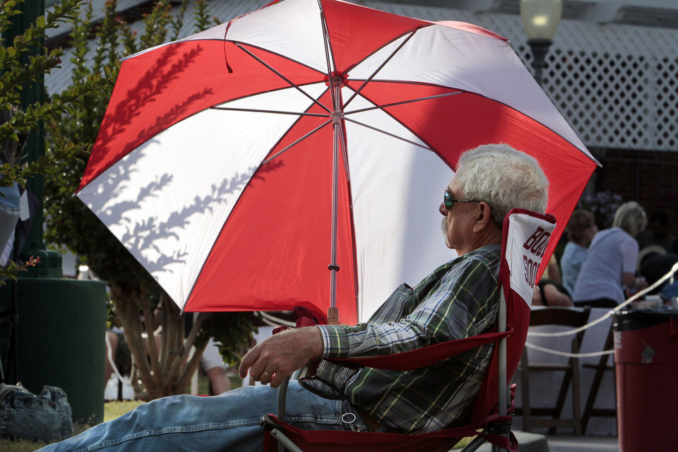 Phil Monenerkit listens to an outdoor concert at last year's Jazz in June festival in Norman. This year's festival kicks off Thursday night at Brookhaven Village. OKLAHOMAN ARCHIVES <strong>STEVE SISNEY</strong>