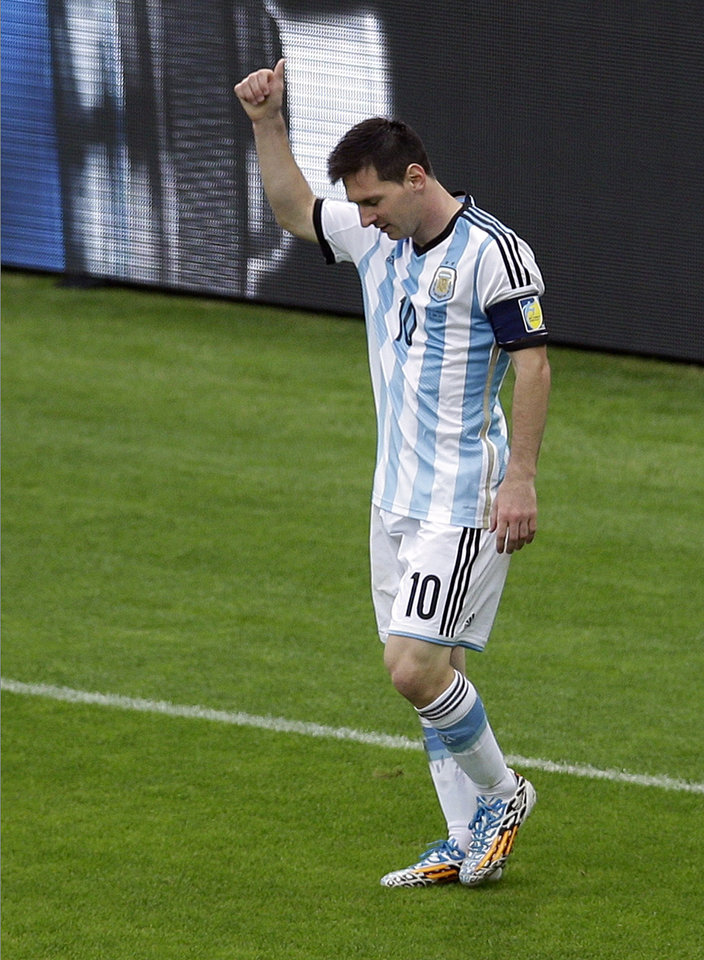 Photo - Argentina's Lionel Messi reacts during the group F World Cup soccer match between Nigeria and Argentina at the Estadio Beira-Rio in Porto Alegre, Brazil, Wednesday, June 25, 2014. (AP Photo/Michael Sohn)