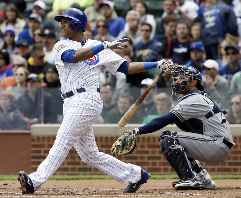 Photo - Chicago Cubs' Starlin Castro watches after hitting an RBI double during the first inning of a baseball game against the Milwaukee Brewers in Chicago, Saturday, May 17, 2014. (AP Photo/Nam Y. Huh)