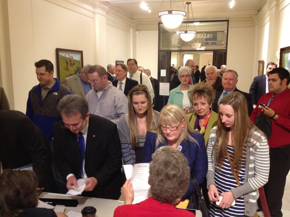 Photo - Candidates file for office at the state Capitol Wednesday morning. Photo by Jim Beckel