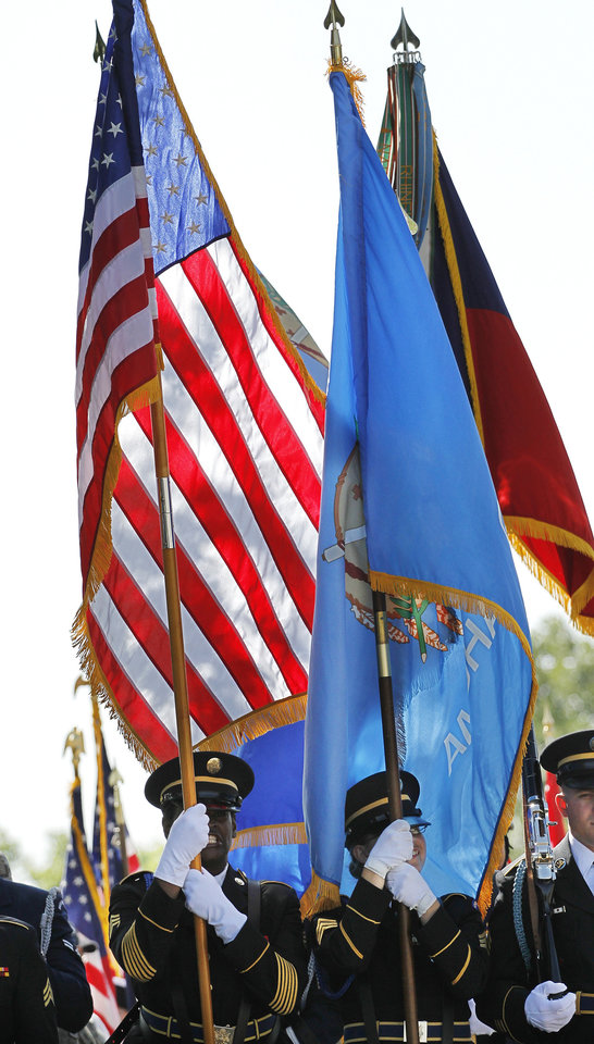 Color guards representing a wide array of organizations and branches of the armed services carried flags during the massing of the colors at the beginning of the Memorial Day Ceremony on the grounds of the 45th Infantry Division Museum  on Monday,  May 28,  2012,  Photo by Jim Beckel, The Oklahoman