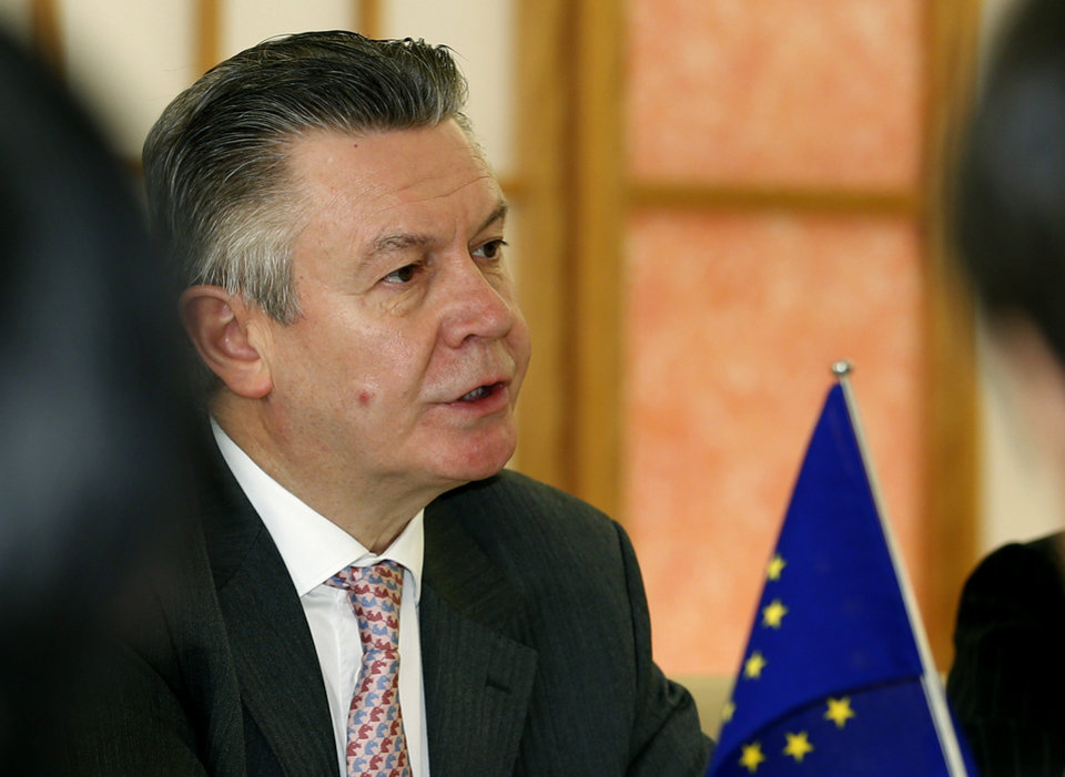 Photo - European Trade Commissioner Karel De Gucht speaks to Japanese Foreign Minister Fumio Kishida at Japan's Foreign Ministry in Tokyo, Monday, March 25, 2013. Japan's prime minister will discuss a possible free trade pact with the European Union even as a summit in Tokyo to launch the negotiations is postponed because of the financial crisis in Cyprus. De Gucht is in Tokyo and meeting with Japanese government and business officials as scheduled. (AP Photo/Shizuo Kambayashi)