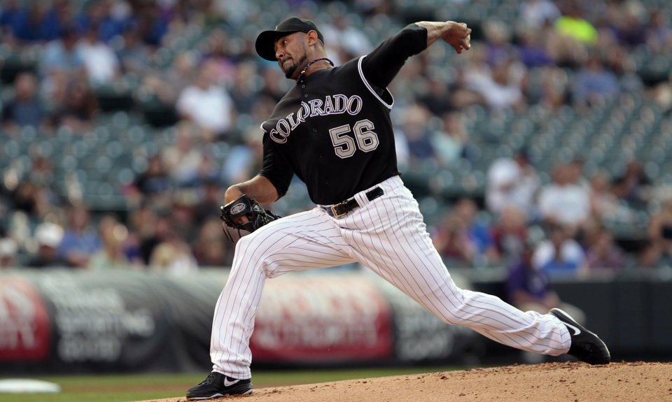 Photo - Colorado Rockies starting pitcher Franklin Morales (56) pitches against the San Diego Padres in the first inning of a baseball game in Denver on Tuesday, July 8, 2014. (AP Photo/Joe Mahoney)