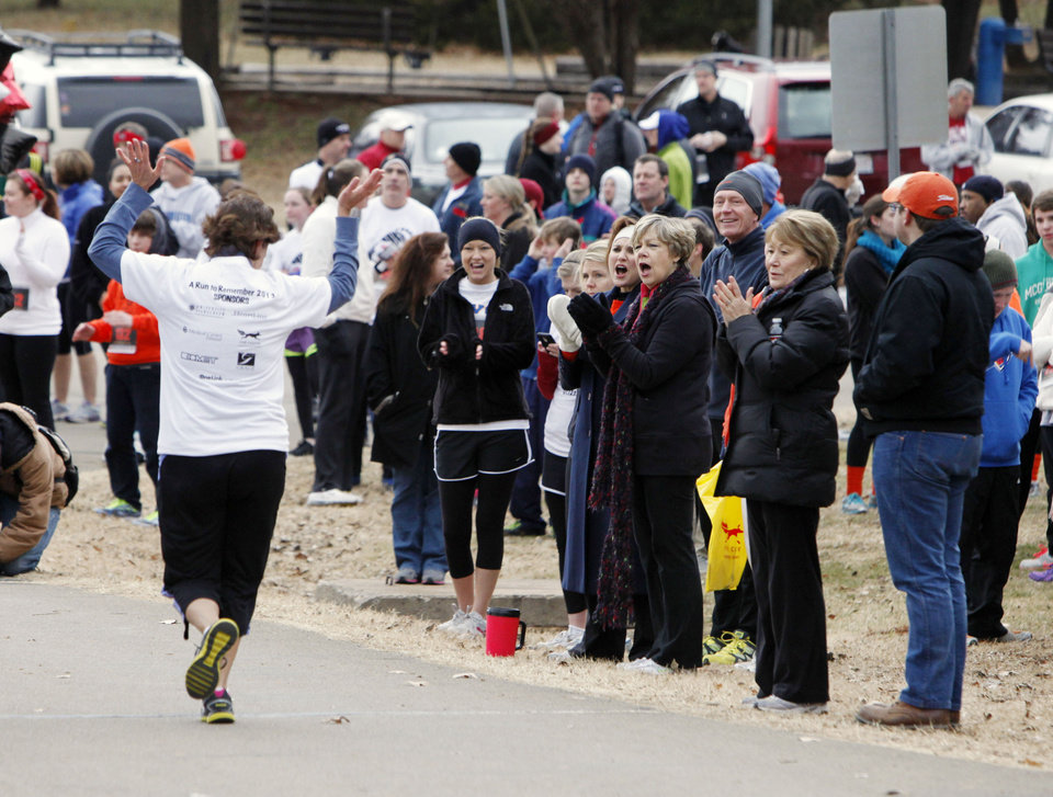 Runners are cheered on as they finish the Forever Edmond fun walk and run at Hafer Park in Edmond, OK, Saturday, January 12, 2013. The walk and run was held for the first time to raise money for American Foundation for Suicide Prevention.  By Paul Hellstern, The Oklahoman
